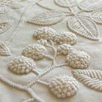 Mountmellick embroidery featuring blackberry fruit and leaves